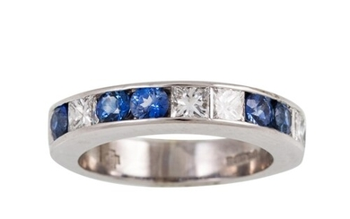 A DIAMOND AND SAPPHIRE HALF ETERNITY RING, set with princess...