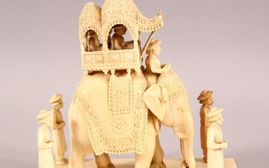 A FINE 19TH CENTURY INDIAN CARVED IVORY ELEPHANT GROUP, the ...