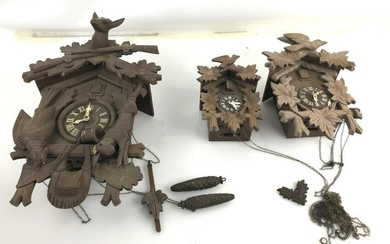 """A Group of 3 Cuckoo Clocks Largest is 19"""" h x 14""""w."""