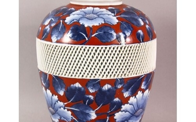 A JAPANESE BLUE AND RED PORCELAIN VASE, the body with a reti...