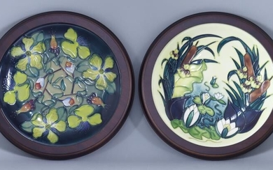 A Moorcroft Pottery Plate With Lamia Design, decorated with...