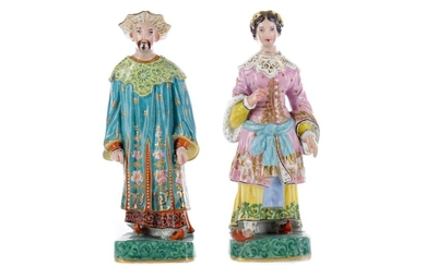A PAIR OF MID-19TH CENTURY CONTINENTAL PORCELAIN FIGURAL TAPERSTICKS