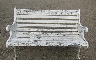 A Victorian style garden bench , the cast iron ends with fol...