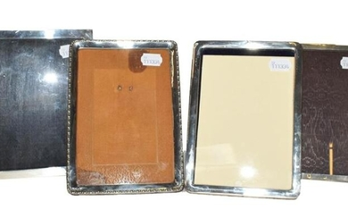 A collection of Four Various Silver-Mounted Photograph-Frames, each oblong, three...