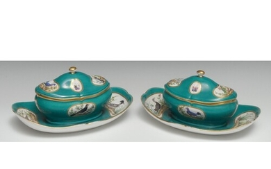 A pair of Sèvres ornithological sugar bowls and covers on fi...