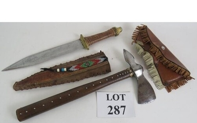 A steel headed tomahawk throwing axe with leather cover and ...
