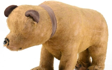 Early 20th-century straw-filled bear, 45cm in length.