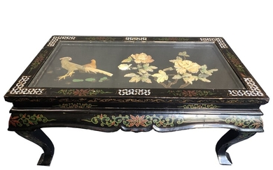 Table, low rectangular top, on four curved legs, richly inlaid with mother-of-pearl inlays in flora
