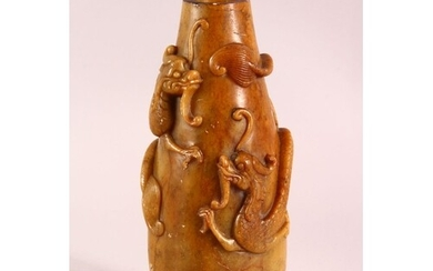 A CHINESE CARVED SOAPSTONE VASE, carved with dragons to the ...