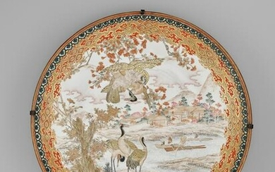 A LARGE ENAMELED KUTANI PORCELAIN CHARGER