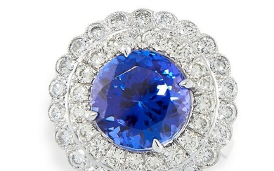 A TANZANITE AND DIAMOND RING set with a round cut