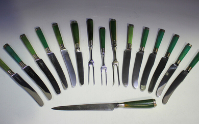 A collection of George III and later silver mounted green stained ivory handled cutlery, comprising