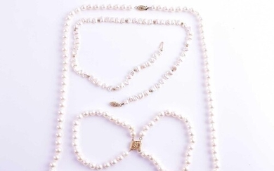 A cultured pearl necklace with yellow metal clasp, together ...