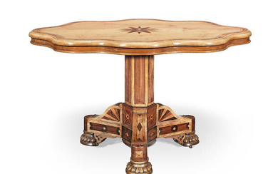 A mid Victorian lace (or plane) wood, tulipwood, ash, ebony and mahogany centre table