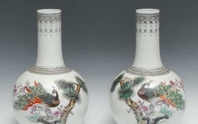 A pair of Chinese Republic ovoid vases, decorated with peaco...