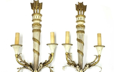 A pair of Italian painted and gilt wall sconces