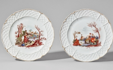 A pair of Nymphenburg porcelain plates with peasant scenes