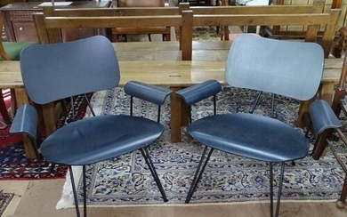A pair of contemporary over-dyed lounge chairs, by Diesel wi...