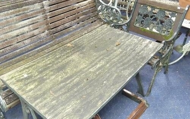 A pair of vintage cast-iron framed wooden Garden Chairs, the...