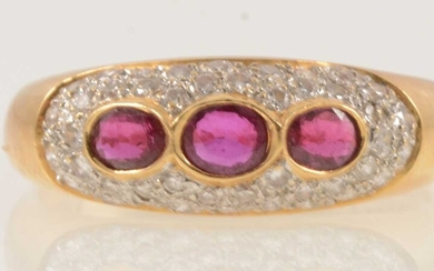 A ruby and diamond dome shape ring.