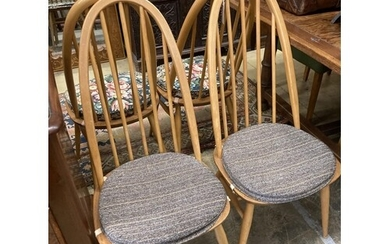 A set of four Ercol light beech comb back Windsor dining cha...