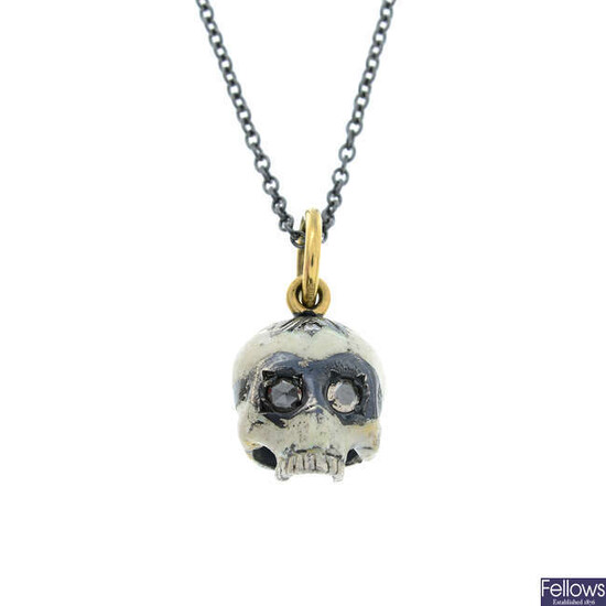 A silver enamel skull pendant with 18ct gold bail and rose-cut diamond eyes, with chain.