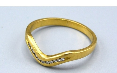 An 18ct Yellow Gold Diamond Set Ring of V Shape set with ele...