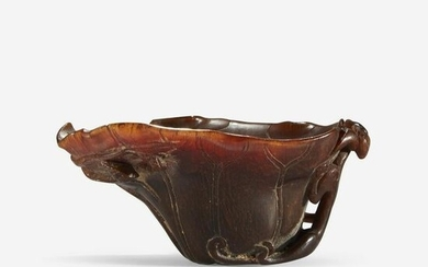 A Small Chinese Carved Rhinoceros Horn Libation Cup
