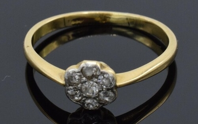 18ct gold daisy ring set with diamonds. UK size O. 2.1 grams...