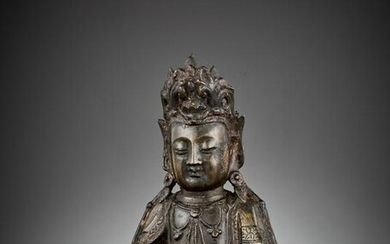 A BRONZE FIGURE OF GUANYIN, LATE MING DYNASTY