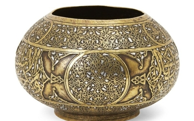 A Cairoware silver inlaid brass bowl, Egypt or Syria, 19th century, on a short foot, decorated with a band to body containing roundels and strapwork and Arabic inscriptions on a dense ground of scrolling vine, 16.3cm. diam.