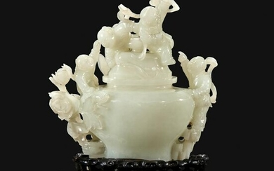 "A Chinese carved white jade ""Boys"" vase and cover"