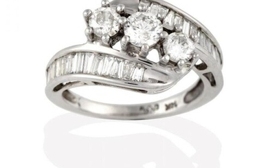A Diamond Three Stone Twist Ring, the graduated round brilliant...