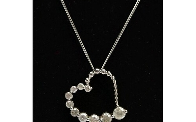 A MODERN 9CT WHITE GOLD DIAMOND HEART AND CHAIN, a witch's g...