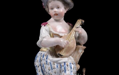 A Meissen figure of a girl playing the lute