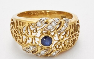 A SAPPHIRE AND DIAMOND RING, a round-cut sapphire in a bezel...