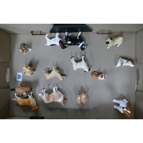 A collection of small Beswick dogs: with Royal Doulton k dog...