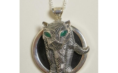 A sterling silver pendant necklace decorated with a panther ...