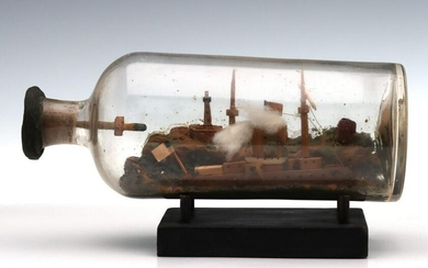 AN EARLY 20TH C. SHIP BOTTLE IN PORT WITH LIGHTHOUSE