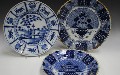 Three Dutch Delft chargers, mid to late 18th century, comprising one painted with a chinoiserie land