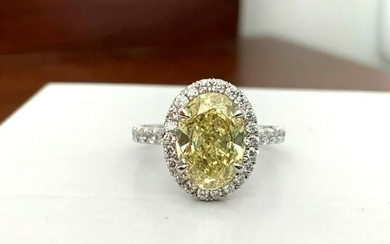 3.21 ct GIA Certified Fancy Yellow OVAL Diamond Ring