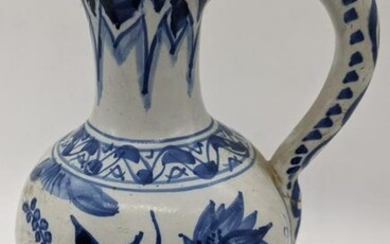 A 19th century or earlier Delft blue and white jug with
