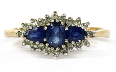 A 9ct gold sapphire and diamond three stone cluster ring