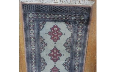 A BUKHARA WOOL RUG the light blue ground with three central ...