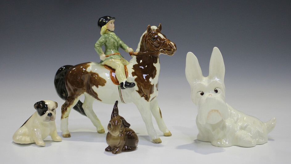 A Beswick skewbald Girl on Pony, model No. 1499 (one leg glued), together with two Beswick animals a