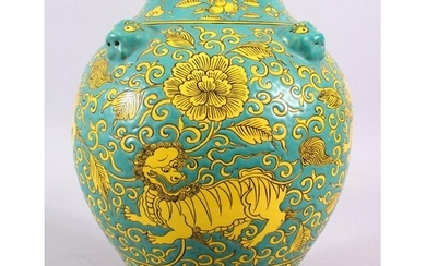 A CHINESE MING STYLE TURQUOISE GROUND PORCELAIN KYLIN VASE, ...