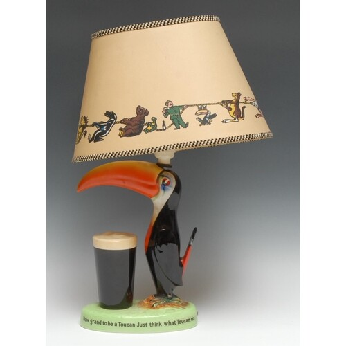 A Carlton Ware Guinness Toucan table lamp, modelled with a t...