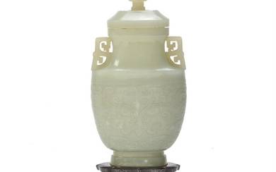 A Chinese pale celadon jade archaistic vase and cover