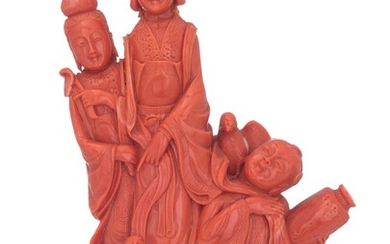 A Chinese red coral sculpture on a wooden...