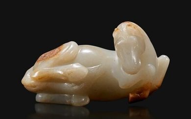 A Chinese russet and greyish-white carved jade figure